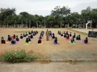 NCC Cadets in SuryaNamaskar posture revealing the significance of Yoga.