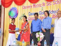 Receiving cycle rider's helmet from the chief guest